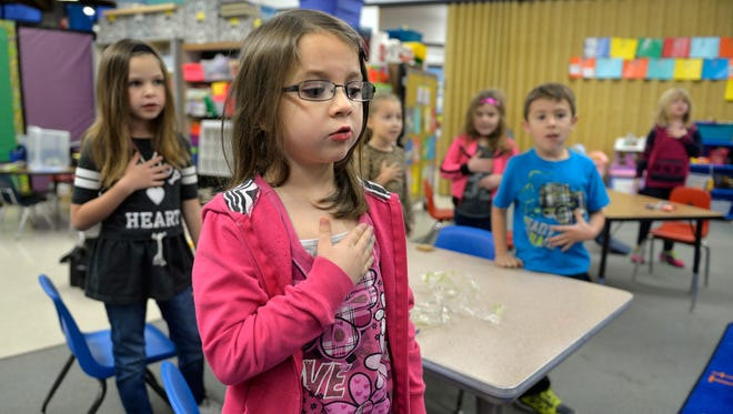Lily Jonak, center, and the other students in Erin Tronbak's kindergarten class say the Pledge of Allegiance in 2015 at Pleasantview Elementary School in Sauk Rapids.