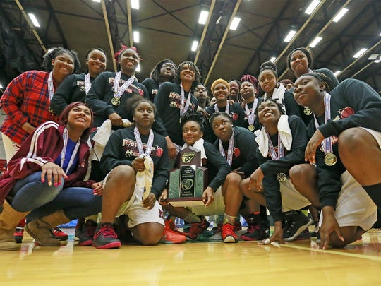 Madison County team with the FHSAA 1A Girls State Championship Basketball trophy after defeating Trenton 73-58 at the Lakeland Center in Lakeland, Florida February 17, 2016. The Ledger/Pierre DuCharme