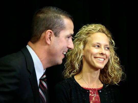 New Bearcats head football coach Luke Fickell and his wife Amy smile after a press conference to introduce the new University of Cincinnati football head coach in the Lindner Center on UC's campus in Cincinnati on Saturday, Dec. 10, 2016. New head coach Luke Fickell comes to UC from a defensive coordinator position at Ohio State University.
