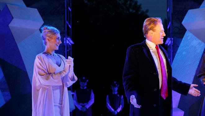 In this May 21, 2017, file photo provided by The Public Theater, Tina Benko, left, portrays Melania Trump in the role of Caesar's wife, Calpurnia, and Gregg Henry, center left, portrays President Donald Trump in the role of Julius Caesar during a dress rehearsal of The Public Theater's Free Shakespeare in the Park production of 'Julius Caesar.'