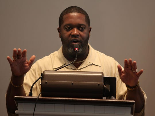 The Rev. Chris Curry of Ezion Fair Baptist Church addresses the investigation into discrimination of African American state employees during his sermon Aug. 2.