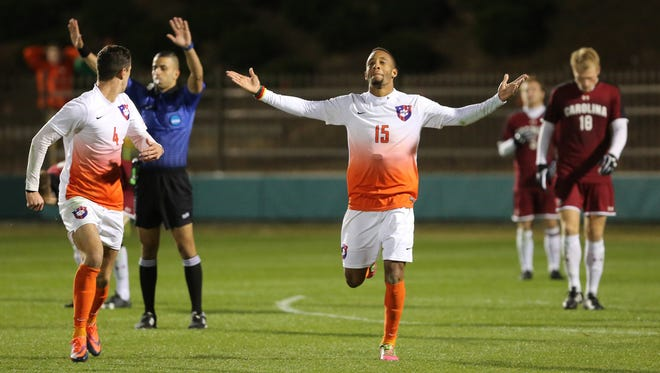 Clemson Tigers Alex Happi (15) celebrates after scoring the game winner in overtime against the South Carolina Gamecocks in the second round of the NCAA tournament Sunday at Historic Riggs Field, November 20, 2016.