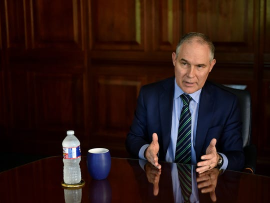 EPA Director Scott Pruitt speaks to reporters at The