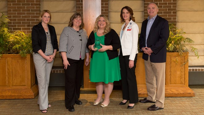 State Journal staff join McLaren Greater Lansing in congratulating the 2016 Nurse of the Year. (from left) Staci Holmes, LSJ advertising manager; Stephanie Angel, LSJ executive editor; Mary Robinson, 2016 Nurse of the Year; Camille Jensen, McLaren Greater Lansing; Brian Priester, LSJ president & publisher
