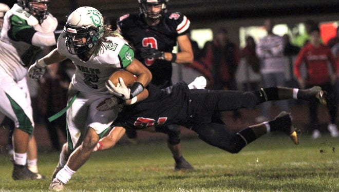 Clear Fork's Trevon Trammell escapes the grasp of Pleasant high school defensive player during a game on Friday night.