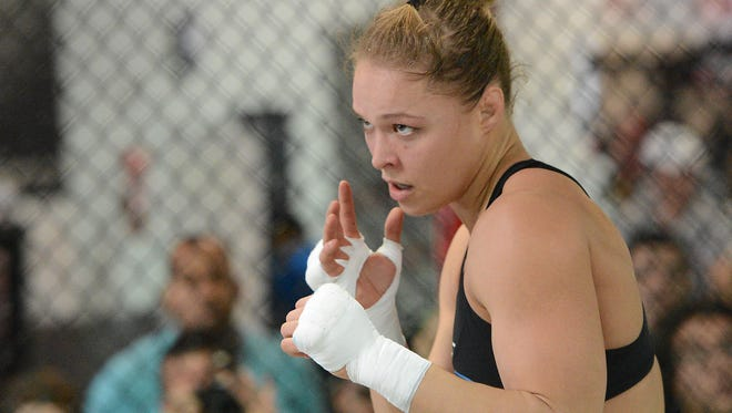 Ronda Rousey, shown in 2013, made her MMA debut in March 2011.