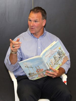 Bill Burkhead reads a book to a West Elementary classroom during a school event in 2014.