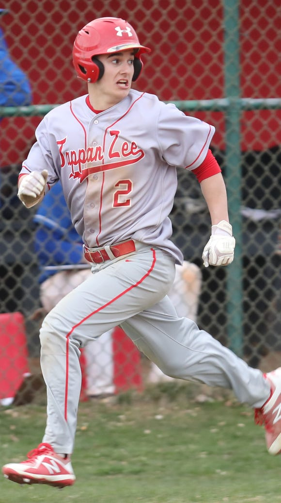 Tappan Zee's Tommy McGivney (2) scores during baseball