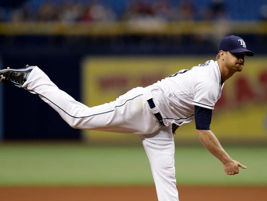 Tampa Bay Rays' Alex Cobb follows thorough on a pitch to the New York Yankees during the first inning of a baseball game, Wednesday, April 5, 2017, in St. Petersburg, Fla. (AP Photo/Chris O'Meara)