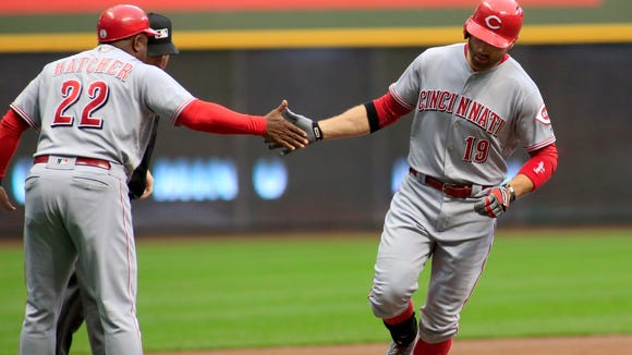 The Cincinnati Reds' Joey Votto, is congratulated by