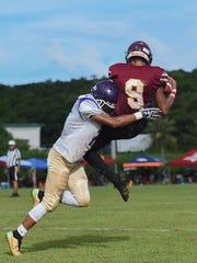 George Washington gecko Aaron Jamanila (12) tackles