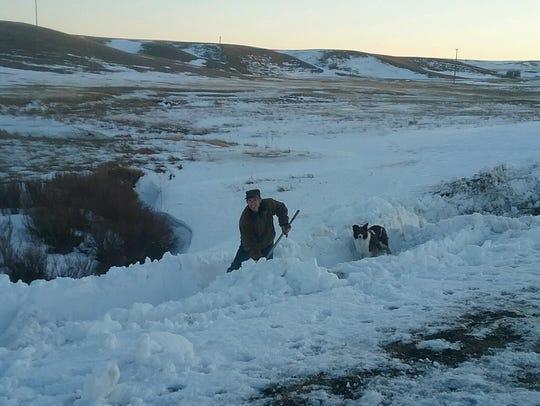 Lisa Schmidt uses her recently-tested shoveling skills