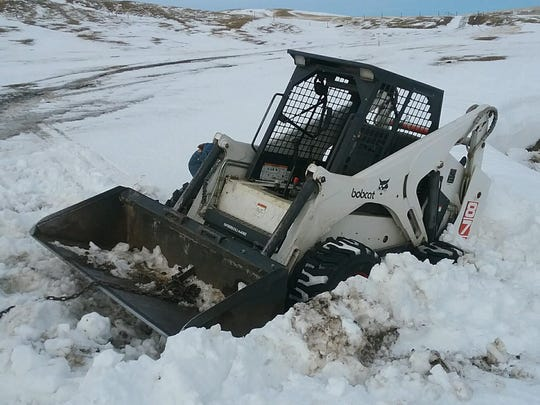 Five feet of drifted snow along a creek bank can suck a skid steer right over the edge. Just ask Steve Hutton how that might happen.