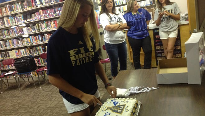 Macon-East's Deven Kennedy, her family and the Knights celebrated Kennedy's signing with Florida International softball on Monday at the school.