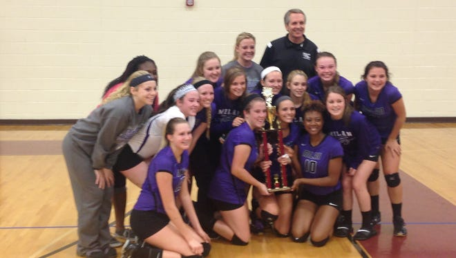 Milan's volleyball team posed with a trophy Saturday after winning the Crockett County Invitational.