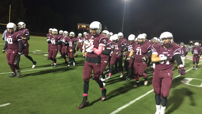 Aquinas takes the field before its game against Buffalo Canisius.