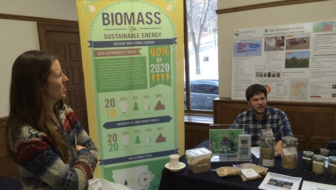 A representative from the University of Iowa Office of Sustainability answers questions about biomass at the Iowa Organic Conference, held at the Iowa Memorial Union from Sunday to Monday.