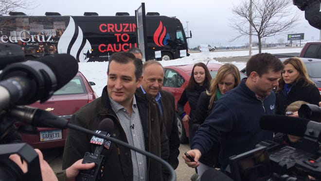 Republican presidential candidate Ted Cruz meets reporters outside King's Christian Bookstore in Boone on Monday