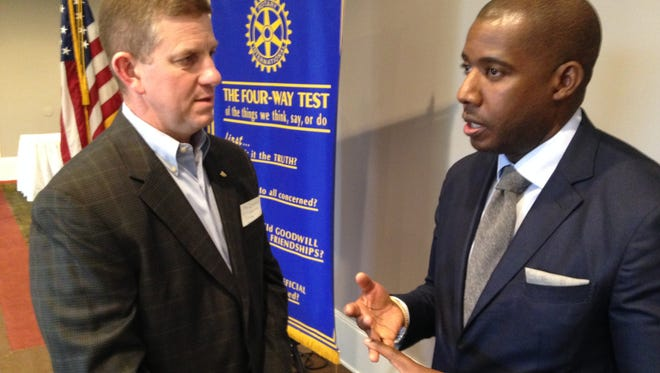 Douglas Scarboro, regional executive vice president for the Memphis Executive Department of the Federal Reserve Bank, speaks with James Dusenberry, Jackson city president for Regions Bank and president of Regions' West Tennessee Community Markets.