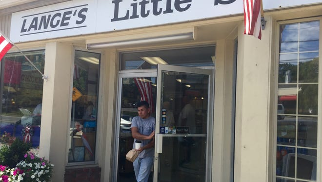 A customer leaves Lange's Little Store & Delicatessen on Tuesday.
