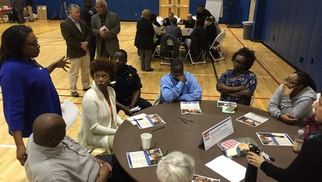Mayor Lovely Warren talks with some of the community members who gathered Monday at the Thomas P. Ryan Community Center for the first of five forums to discuss police-community relations.
