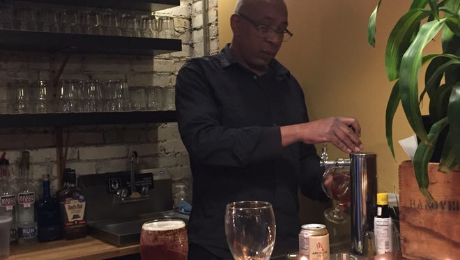 Bartender Gerald Knowles crafts a cocktail at Warehouse Gourmet's new downstairs bar. Owners Melinda and Keith Stambaugh will hold a grand opening for the new bar on Jan. 28.