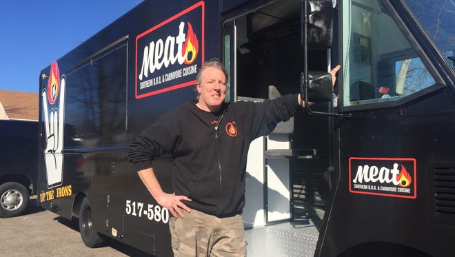 Sean Johnson, owner of Meat Southern BBQ, poses next to his food truck on March 7. He will launch the food truck service on March 17.