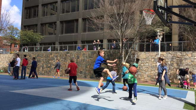 Kids enjoy Greenville's Fan Fest during the NCAA Tournament in Downtown Greenville. Saturday, March 18, 2017.
