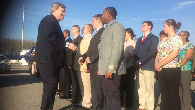 Memphis Mayor Jim Strickland shakes the hands of police officer and service technician recruits at a ceremony Monday welcoming the city's largest public safety class since 2010.
