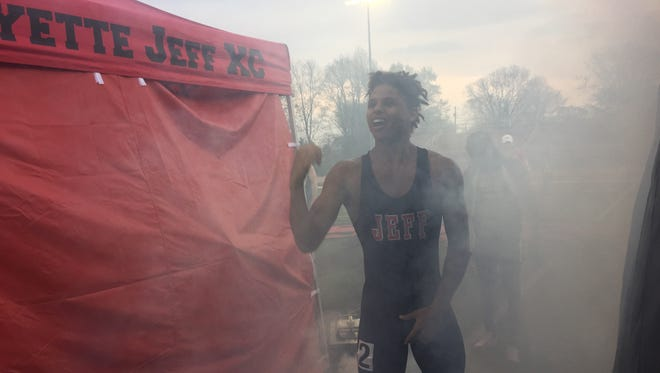 LafayetteJeff  junior Avarey Walker pumps himself up amidst a fog machine as he is introduced for the 200 at Friday's Sprinter Showcase event at Scheumann Stadium.