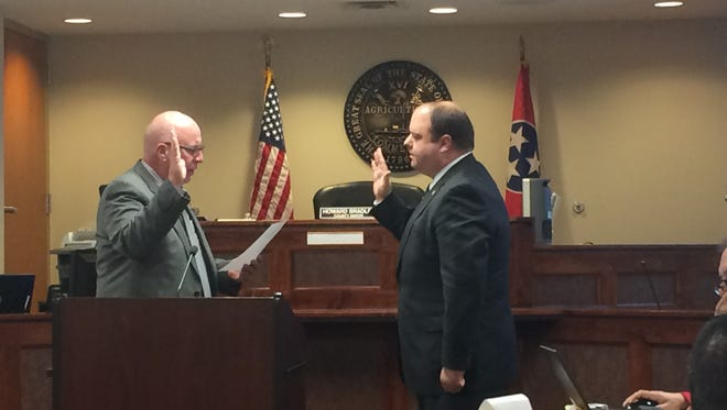Robertson County Mayor Howard Bradley administers the oath of office to newly appointed Commissioner Joshua Evans on Monday, May 15, 2017.