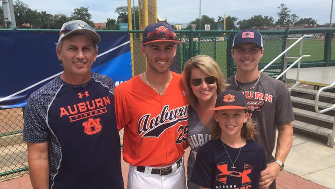Jay Estes (orange jersey) poses with his family after Auburn's 7-4 win at Dick Howser Stadium.