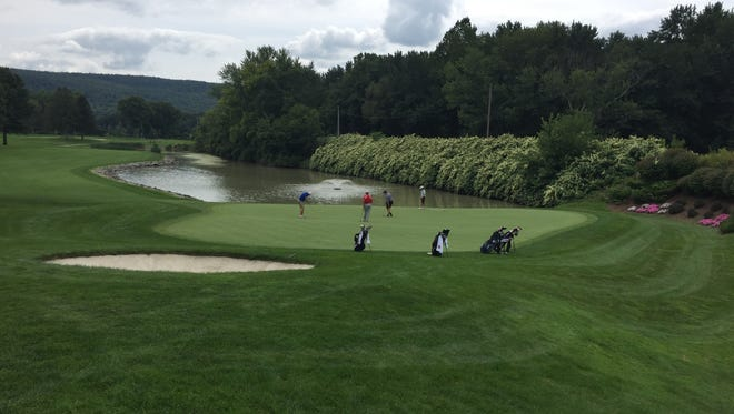 Action on the 15th green from Monday's Nick DiNunzio Memorial Tournament at En-Joie Golf Course.