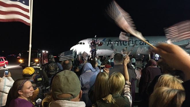 Hundreds of people waved flags and cheered at the Purdue Airport to welcome home a Greater Lafayette Honor Flight in 2015. Organizers are hoping for a similar turnout Monday when 85 Vietnam veterans return from a one-day trip to Washington, D.C., to see the Vietnam Memorial.