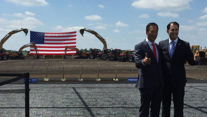 "Gov. Scott Walker, seen here with Foxconn Chairman Terry Gou at the groundbreaking ceremony for the company's manufacturing campus in Mount Pleasant, will travel to Eau Claire Monday with another Foxconn executive to make ""a major economic development announcement."""