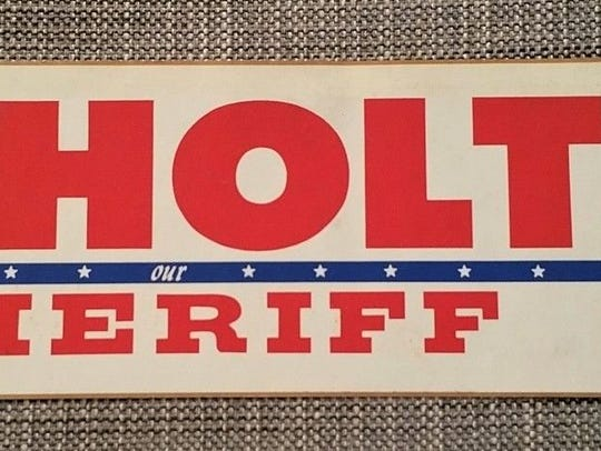 Political sticker in 1976 for sheriff's election.