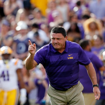 FILE - In this Sept. 8, 2018, file photo, LSU head coach Ed Orgeron leads his team before an NCAA college football game against Southeastern Louisiana, in Baton Rouge, La. Orgeron was the odds' on favorite to be the first SEC coach fired but has his Tigers are one of the league's last undefeated teams. (AP Photo/Gerald Herbert, File)