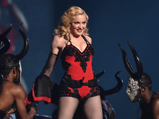 Madonna, performing at the 57th annual Grammy Awards in Los Angeles, has been criticized for remarks panning her hometown.