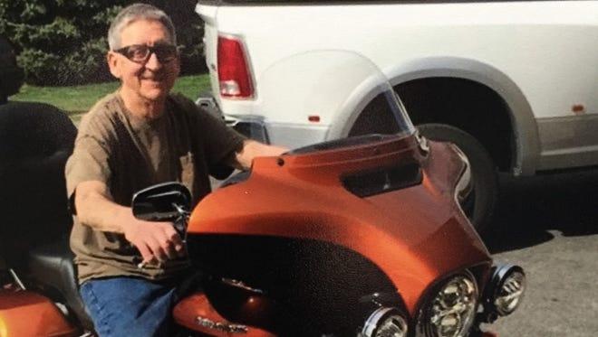 Bob Henry astride his Harley.