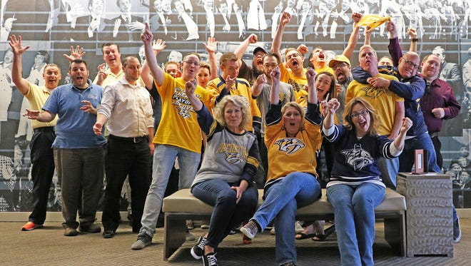 Barbershop Harmony Society employees celebrate Predators Day.