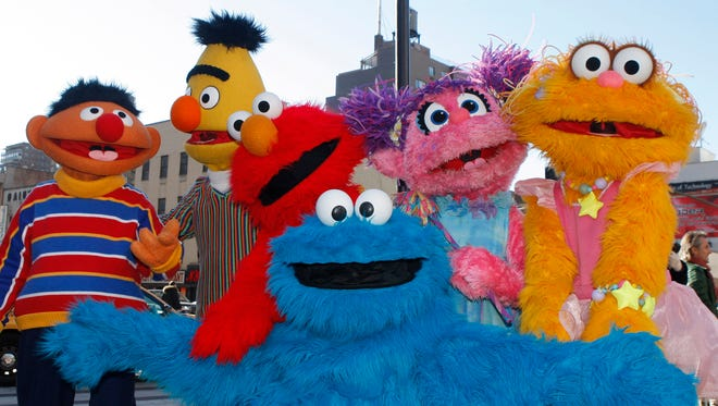 In this Feb. 10, 2010, file photo, characters from Sesame Street Live appear on the street by Madison Square Garden to celebrate the 30th anniversary of the live touring stage shows based on the PBS television series.