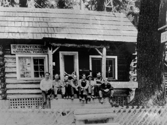 A historic photo is seen of one of Fish Lake's cabins.