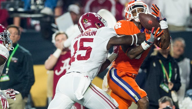 Alabama defensive back Ronnie Harrison (15) breaks up a pass against Clemson wide receiver Artavis Scott (3) in the end zone in the College Football Playoff Championship Game on Monday January 11, 2016 at University of Phoenix Stadium in Glendale, Arizona.