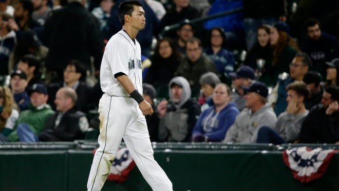 Seattle Mariners' Norichika Aoki walks to the dugout after he grounded out to first with the bases loaded to end the seventh inning of a baseball game against the Texas Rangers, Monday, April 11, 2016, in Seattle. (AP Photo/Ted S. Warren)