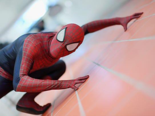 Spider-Man climbing a wall.