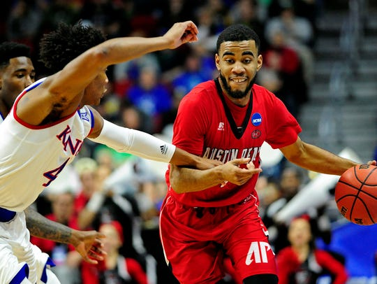 Austin Peay guard Josh Robinson (4) drives to the basket