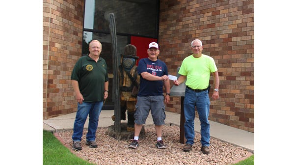 Pictured, from left, are club members, Dale Evers and Sam Domeier, presenting the check to Fire Chief Ron Zinniel.