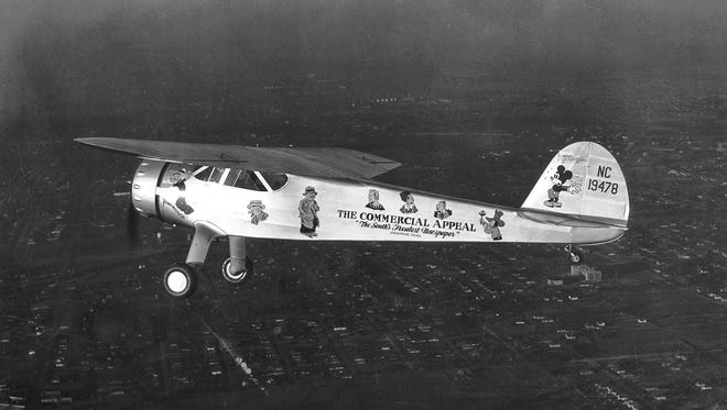 January 20, 1939 - The Commercial Appeal purchased a series of airplanes in the 1930s, including this white plane decorated with comic strip characters. This photograph of the plane was taken as it flew over Memphis on Jan. 20, 1939.  George Stokes was hired as pilot to fly reporters to the scenes of news stories, sports writers to games and editors to meetings and conferences. Stokes taught himself to be a competent photographer and even invented a method of developing pictures in the air while returning from an assignment.  While flying a goodwill mission on May 2, 1939, Stokes and reporter Ted Northington along with John Crump, the youngest son of E.H. Crump, were all killed near Grenada, Mississippi.