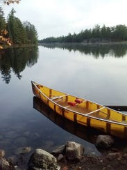 A canoe rests on the shore of Hegman Lake in the Boundary