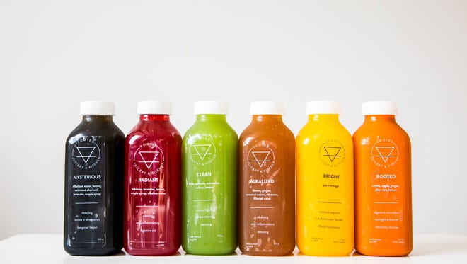 """Rooted Juicery + Kitchen offers cold-pressed juices and mylks, like """"Clean,"""" which has kale, spinach, cucumber, celery and lemon."""